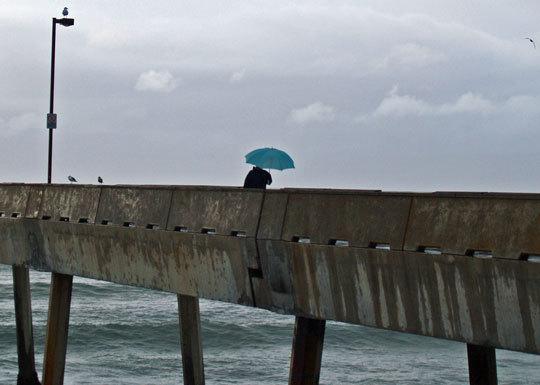 Blue umbrella on the pier