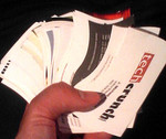 Hand of business cards