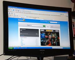 CozmoTV displayed on an LCD TV